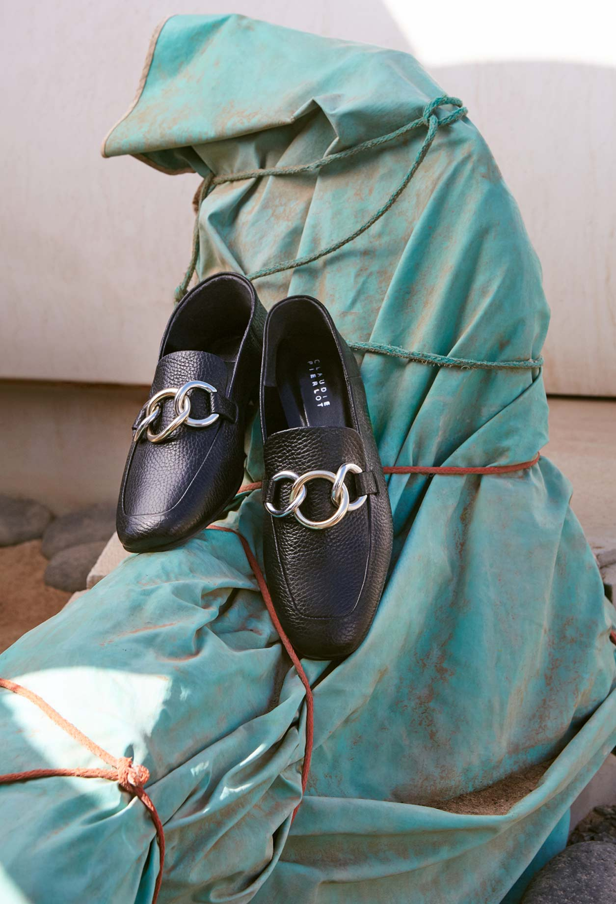 Loafers with silver chains