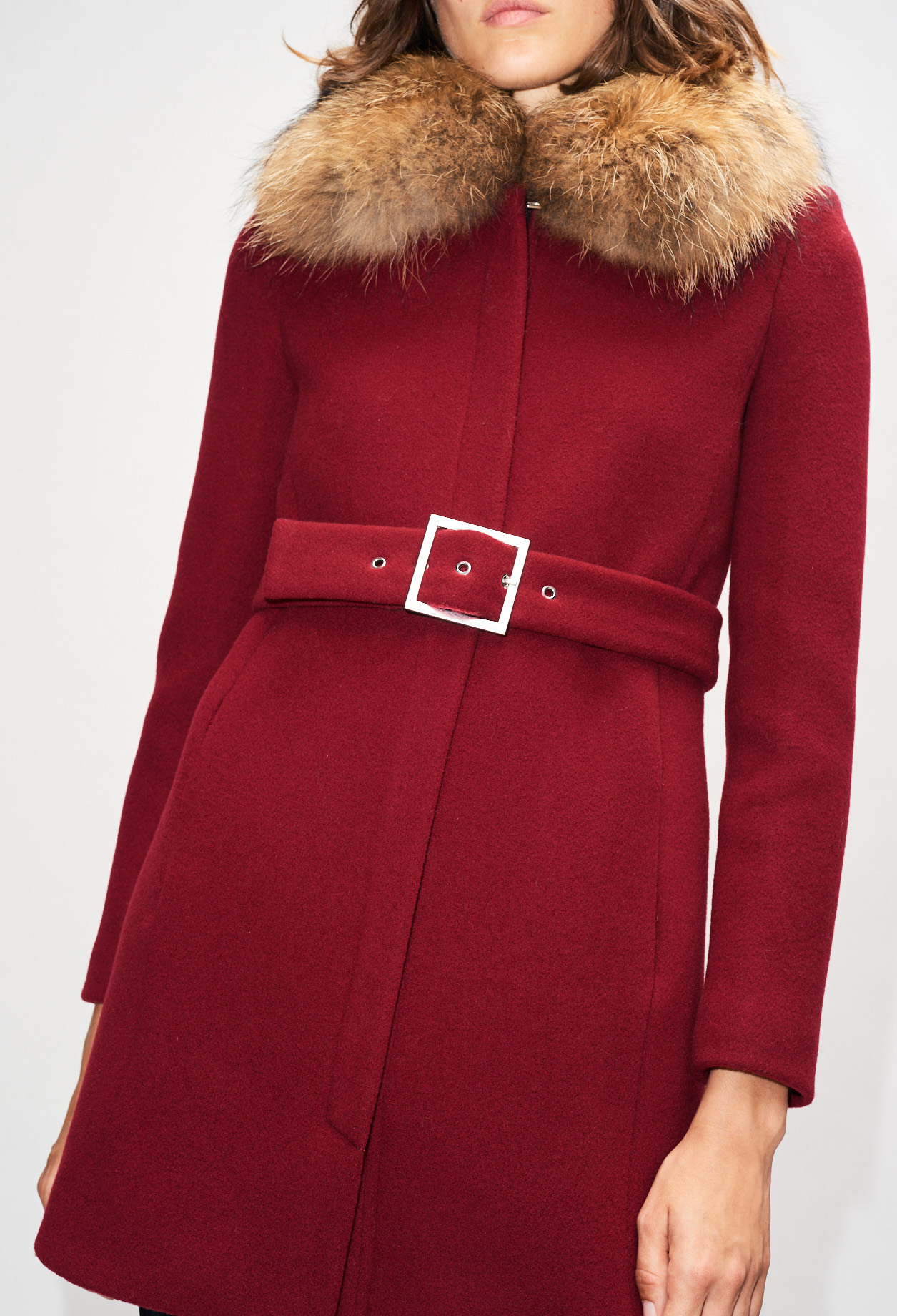 Waisted coat with fur collar